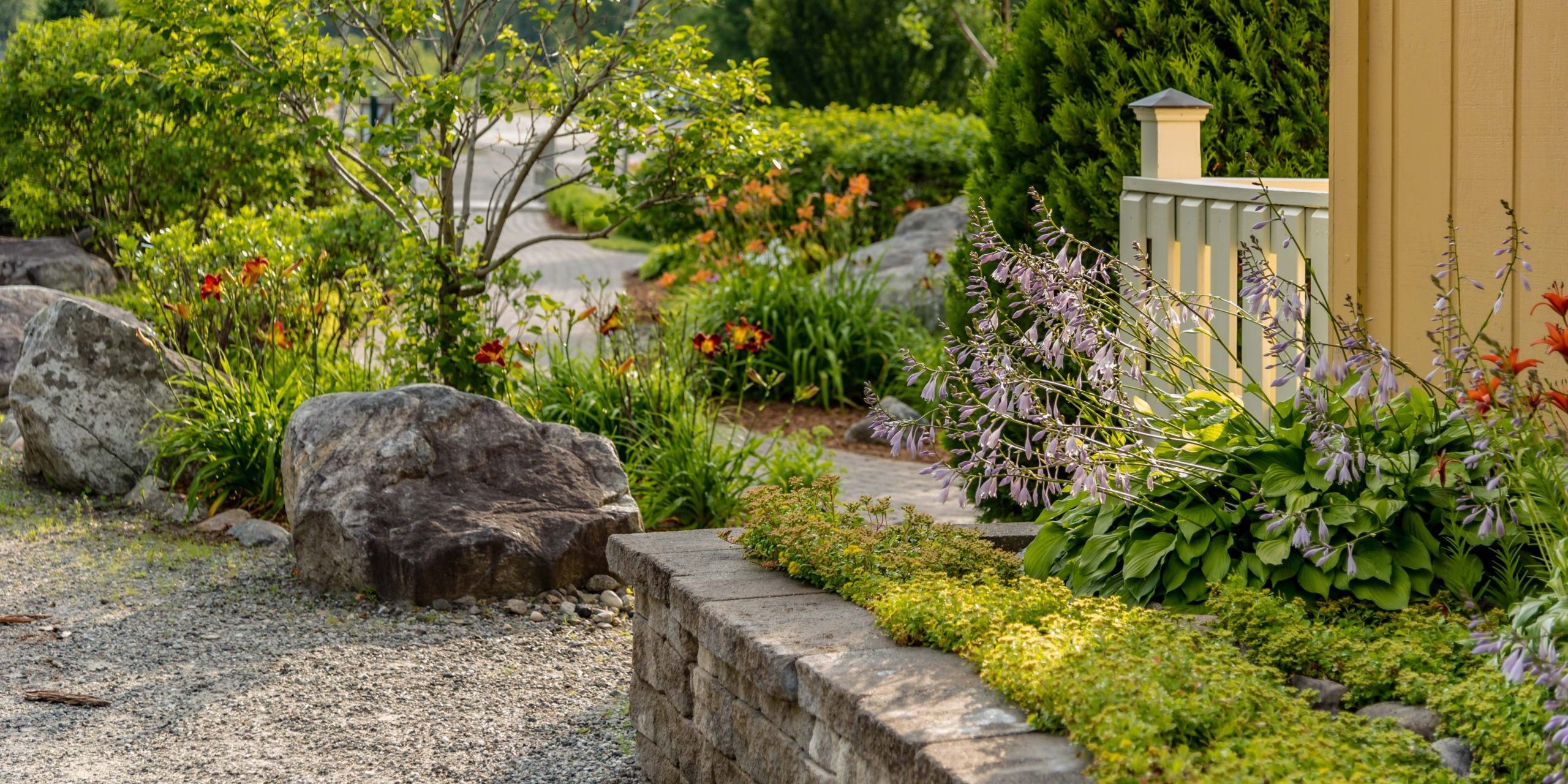 stone wall with landscaping and decorative rocks
